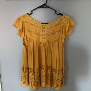 Yellow short sleeve blouse